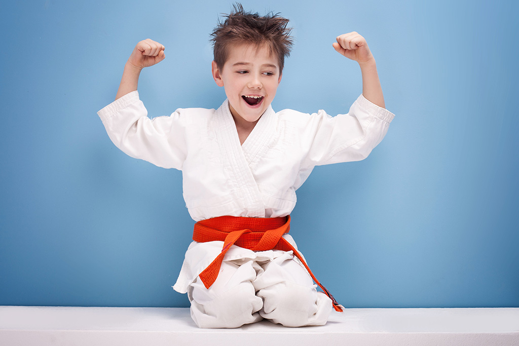 Martial Arts for students with ADHD - Kid Flexing